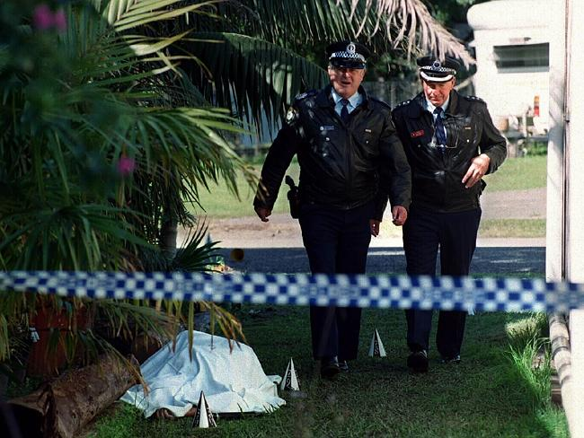 Senior police officers next to the covered body of McGowan.