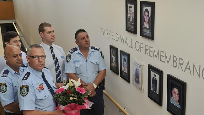 Friday was the 17th anniversary of the murder of David Carty. Fairfield police officers held a minute's silence at the station's Wall of Remembrance. Picture: Tim Clapin