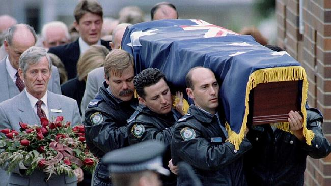 Police carry the coffin of Senior Constable Peter Addison.