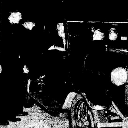 LOWER RIGHT: A detective-sergeant checking his rifle before joining the search. A spotlight was attached to the barrel of the gun.