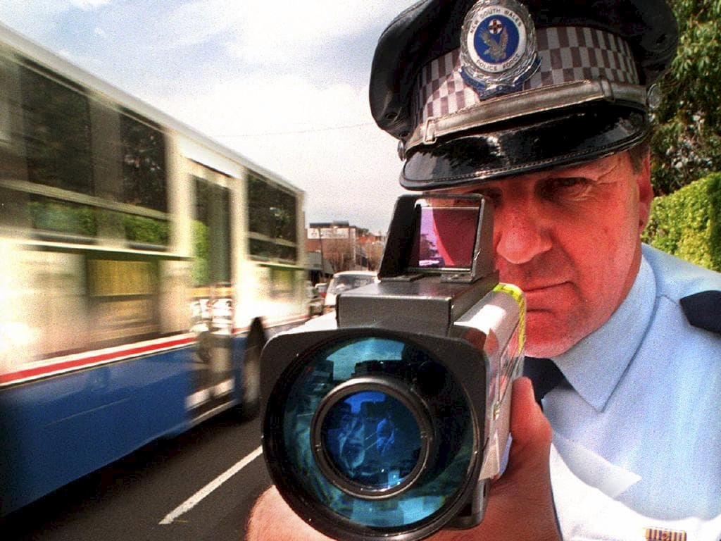 Senior Sergeant Ray Smith uses a radar gun on Parramatta Road, part of the Operation Slow-down campaign in 1997.