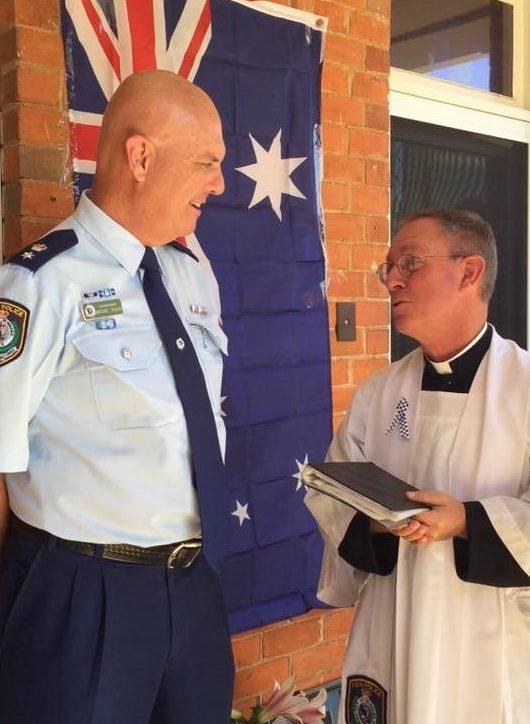 Superintendent Mick Rowan # 22980 ? ) with Father Robert offer kind words. — with Robert Patrick Murphy