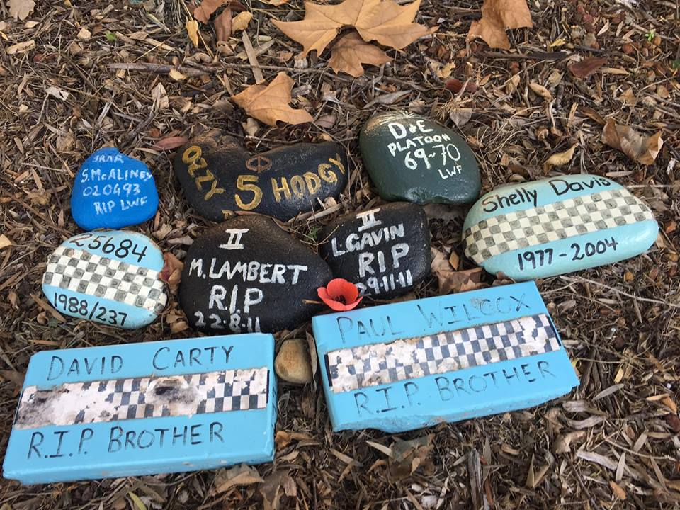"A small section of St John Of God, Richmond Hospital, where Police ( and others ) with PTSD have gone for Inpatient Treatment.<br />  <br />  This is a small Memorial that previous patients ( Police ) have done to remember our friends who have fallen before us. The Black & Dark Blue Memorial stones are by Army members<br />  <br />  Details mentioned:<br />  <br />  <br />  <br />  JRNR<br />  <br />  S. McALINEY<br />  <br />  020493<br />  <br />  RIP LWF<br />  <br />  <br />  <br />  <a href=""https://www.australianpolice.com.au/todd-malcolm-blunt/"" target=""_blank"" rel=""noopener noreferrer"">25684</a><br />  <br />  1988/237<br />  <br />  ( 25684 = Regd # )<br />  <br />  1988 is year Attested. 237 is the Class # )<br />  <br />  <br />  <br />  <a href=""https://www.australianpolice.com.au/david-andrew-carty/"" target=""_blank"" rel=""noopener noreferrer"">David CARTY</a><br />  <br />  R.I.P. Brother<br />  <br />  <br />  <br />  OZZY 5 HODGY ( Appears to have a Legacy Crest glued to it )<br />  <br />  <br />  <br />  II<br />  <br />  M. LAMBERT<br />  <br />  R.I.P.<br />  <br />  22.8.11<br />  <br />  <br />  <br />  D & E PLATOON<br />  <br />  69 - 70<br />  <br />  LWF<br />  <br />  <br />  <br />  II<br />  <br />  L. GAVIN<br />  <br />  RIP<br />  <br />  29.11.11<br />  <br />  <br />  <br />  <a href=""https://www.australianpolice.com.au/paul-brian-wilcox/"" target=""_blank"" rel=""noopener noreferrer"">PAUL WILCOX</a><br />  <br />  R.I.P. BROTHER<br />  <br />  <br />  <br />  <a href=""https://www.australianpolice.com.au/shelley-leanne-davis/"" target=""_blank"" rel=""noopener noreferrer"">SHELLY DAVIS</a><br />  <br />  1977 - 2004<br />  <br />  Photo posted up on NSW Cops, Old, Bold & Retired FB Group on 28 May 2017."