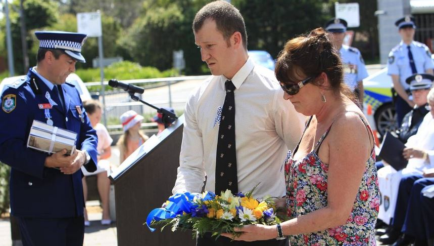 Family members lay a wreath for Det Const Stephen John Tier. Picture: ANDY ZAKELI