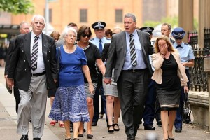 Family and friends of murdered Detective inspector Bryson Anderson and police head into the king st court complex. Picture: John Grainger