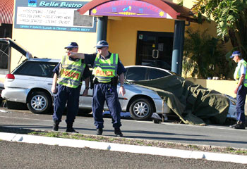 The scene... where two off-duty police officers were struck by a car on the NSW mid-north coast today.