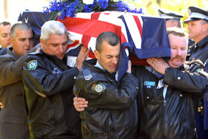 Selfless act of a courageous man ... police colleagues carry the coffin of Sen-Constable Paul Morris. Picture: Rob McKell