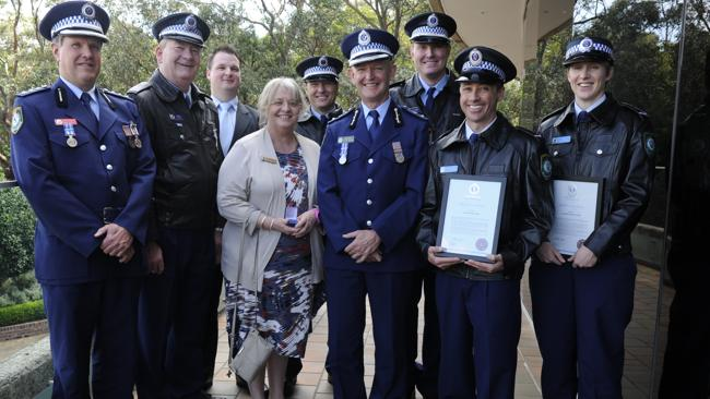 Elizabeth 'Lizzy' BEDELIS receives the 15 Year Lapel Pin to the NSW Police Medallion.