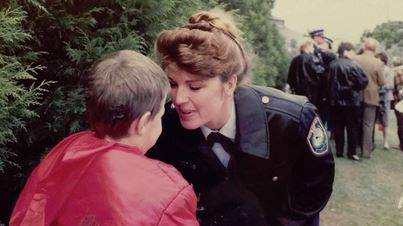 Sandra Mullaly tends to a child during her time as a member of the Wollongong police force.