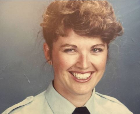 Sandra Mullaly is cheerful in her police photo but her time in the force was anything but.