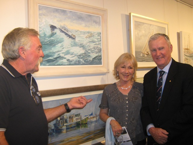 Christine Hill at RMYC Marine Art Exhibition with one of the Falcon-Votan paintings.