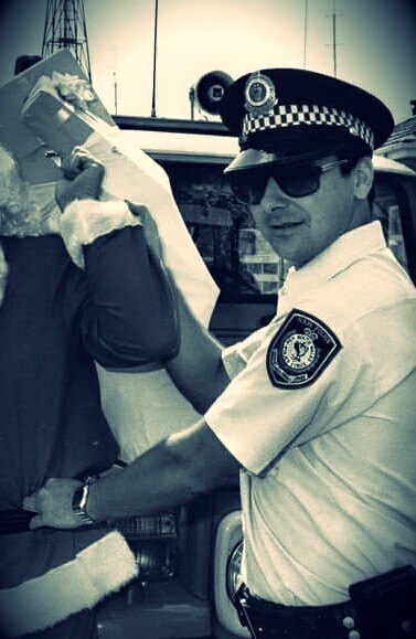 Constable Gary Dunningham arresting Santa Claus