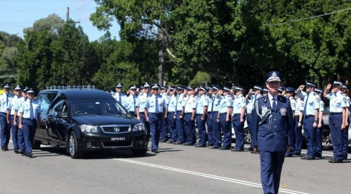 Last salute: NSW Police march at Cecil Abbott's funeral at Penshurst yesterday. Below right, Mr Abbott. Picture: Chris Lane