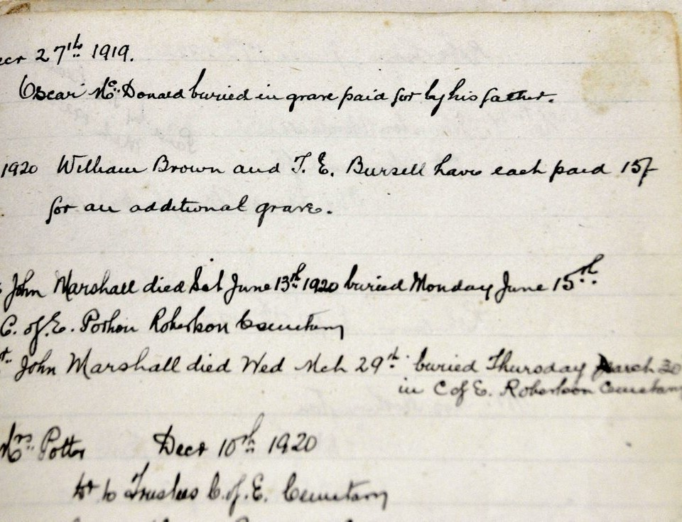Burial record of Oscar McDonald recorded in an old book in the General Store at Robertson.