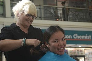 Constable Cheryl Leung had her chest-length hair shaved off to support fellow constable Matthew Montesin.
