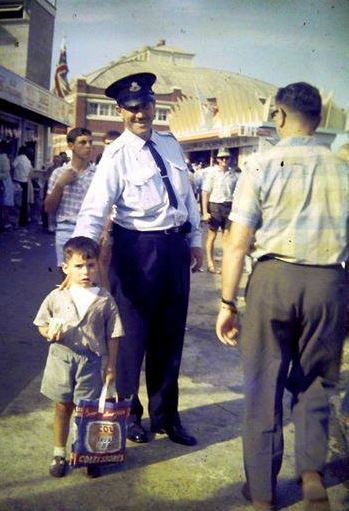Ronald Ivan Blunt at the Royal Easter Show, Sydney with a lost child in the late 50's early 60's.