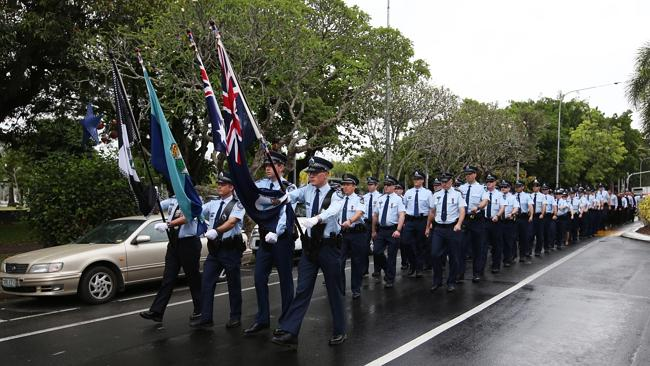 RESPECT: Cairns police march down the Esplanade and towards St John's Anglican church to mark National Police Remembrance Day. Picture: Brendan Radke.