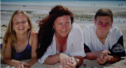 Mrs Nicholson-Rogers with her children.