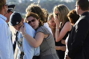 Friends of Adam Dunning after the hearse had left the tarmac. Photo: Andrew Taylor
