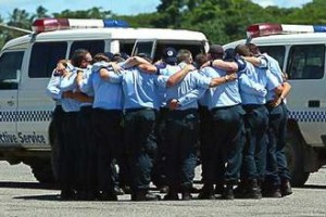 Solidarity ... Eight Federal Police pallbearers carry Adam Dunning's coffin from the plane that brought him from the Solomon Islands. Photo: Andy Zakeli