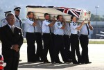 Adam Dunning's coffin is loaded from the aircraft to a hearse at the RAAF Base at Fairbairn. Photo: Andrew Tayl
