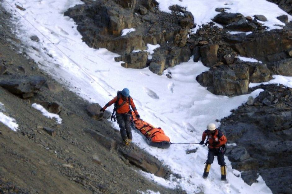 Members of a Bolivian rescue team carry the body of Australian climber Peter Cornelius Wiesenekker