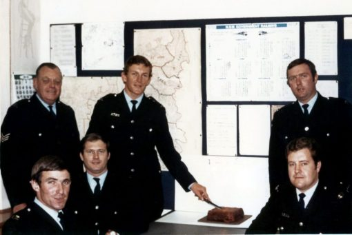 Dave Morris<br /> September 21, 2019 NSW Fallen Police<br /> 1972 and to mark our one year at Waverley STP, Stevo (right side standing) baked a cake. He was a really good cook, the baked dinners were legendary!