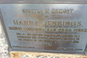 Erected in memory of Harry Jenkings, Senior Constable N.S.W. Police Force who by his gallant rescues and conduct as a policeman and citizen endeared himself to the people of the municipality of Woollahara. 1959. A.F. Ryan, Town Clerk. Alan Frost, Mayor