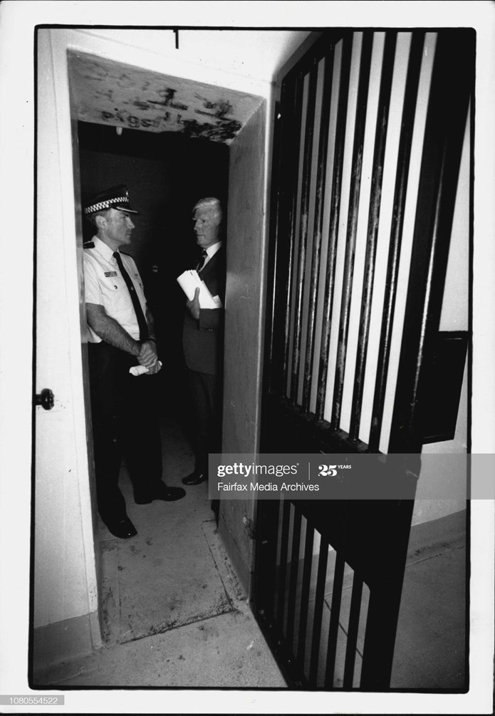 """Lance STIRTON. Deputy Commissioner & State Commander Lance Stirton (Right) & Acting Patrol Commissioner Sid Walsh (left) (Newtown) inspect Newtown Police station cells which apparently don't comply to the Geneva convention.Senior officers inspect the Newtown police cells.The NSW Commander of Police, Deputy Commissioner Lance Stirton, responded to the labelling of Newtown police station cells as """"utterly disgraceful"""" by walking into the cells yesterday and agreeing.Standing in one of the cold, dank cells, Mr Stirton said: """"We just have to take this one on the chin."""" The Ombudsman, Mr. Landa, said in his annual report that prisoners were being kept in conditions that did not meet the minimum standard in the Prison Act. He said some cells contravened the Geneva Convention for prisoners of war. November 15, 1991. (Photo by Alexander James Towle/Fairfax Media via Getty Images)."""