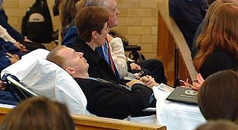 True love ... police officer Brett Wright on stretcher at the funeral of his fiancee Elise Krejci. Picture: Channel 9
