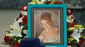 rue love ... a photograph of policewoman Elise Krejci adorns her coffin. Picture: Channel 9