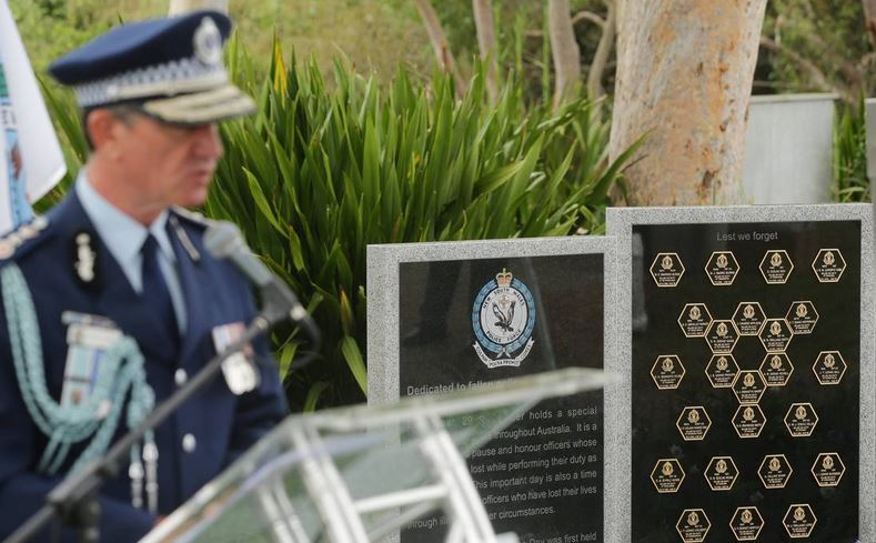 Remembering: NSW Police Commissioner Andrew Scipione helped unveil a new police memorial at Woronora Cemetery Sutherland on Thursday. Picture Chris Lane