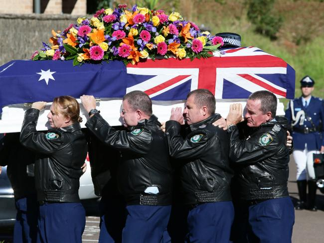 Police pallbearers carry the casket of Senior Constable Tara Tobin, during the funeral held at Our Lady Star of the Sea Church, Terrigal. Picture:Peter Clark