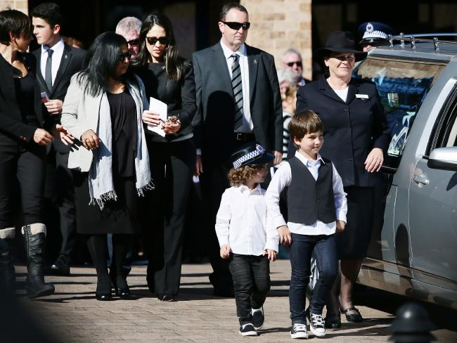Family members farewell Sergeant Tara McLaughlin (Tobin), during her funeral held at Our Lady Star of the Sea Church, Terrigal. Picture:Peter Clark
