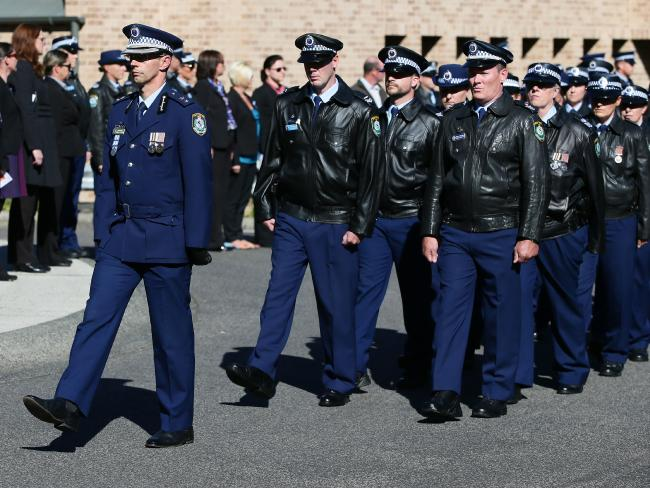 NSW Police officers march at the Terrigal service. Picture:Peter Clark