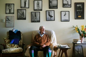 Bill Harris, 99, at his Allawah home with his photos of his acrobat days. Picture: Mark Evans