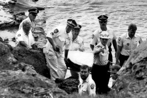 RESCUE AT WOLLONGONG LIGHT HOUSE A/O BOB LEWIS, CST MARK MULREADY, SENSGT TED DOHERTY, SENCON GARY THOMPSON, PARAMEDIC STEVE POLLARD, CST TONY FERRIS, A/O KEVIN DENT (POINTING), PARAMEDIC TERRY MORROW, A/O ANDREW GROVES (PARTIALLY HIDDEN ON LOWER RIGHT) 1988