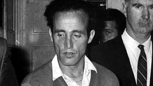 Murderer William McDonald, known as The Mutilator, leaves Burwood Court after he was sentenced to life imprisonment for five killings.