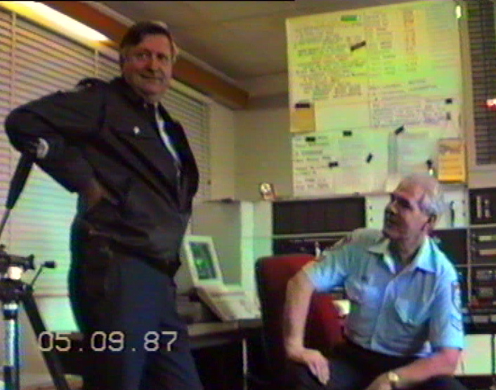 SENIOR CONSTABLE CARL HANSON (SEATED), VKG2, WARILLA POLICE RADIO - SENIOR OPERATIONS OFFICER - SPEAKING WITH SENIOR SERGEANT DICK BROOK, FROM WARILLA POLICE STATION.  1987 - 1988