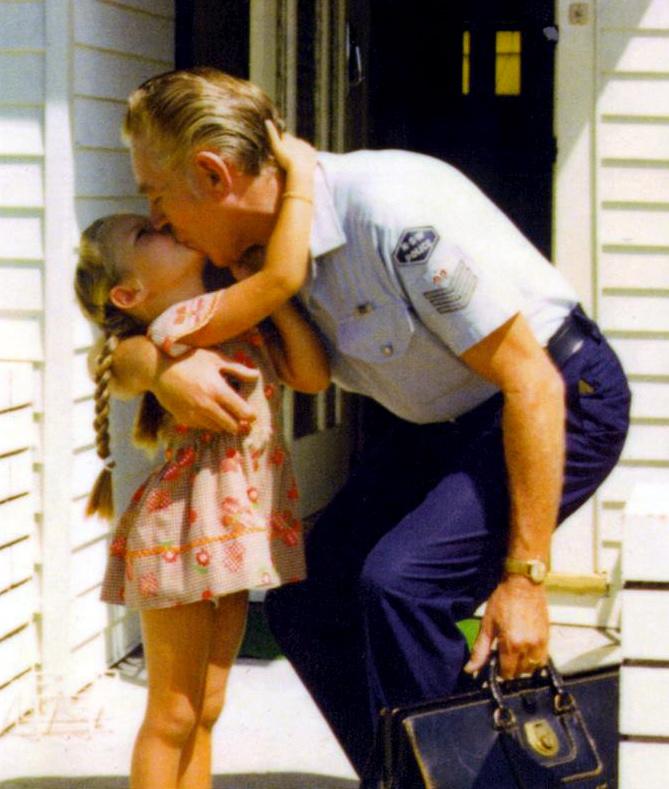 SERGEANT KEITH BEAN - KISSING HIS DAUGHTER - MELINDA.
