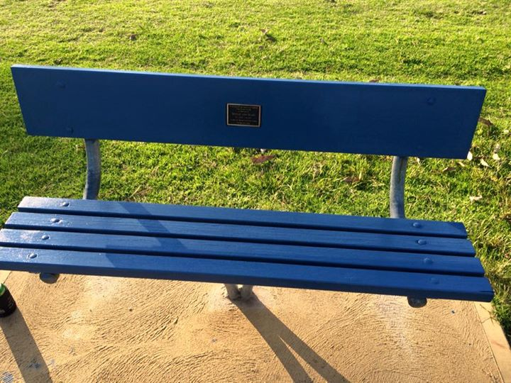 Seat dedicated to Curly Royan on the River Bank of Sussex Inlet River.