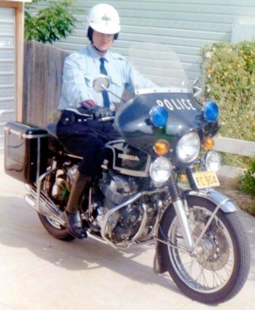 RON ON HIS POLICE MOTOR CYCLE AT WARNERS BAY.