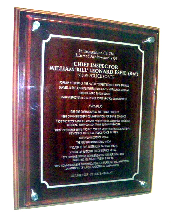 Inscription: In recognition of the life and achievements of Chief Inspector William 'Bill' Leonard ESPIE ( Rtd ) NSW Police Force.Former student of the Hartley Street, School, Alice Springs (N.T.)Served in the Australian Regular Army - Maralinga Veteran2000 Olympic Torch bearerChief Inspector NSW Police Force ( Patrol Commander )AWARDS1965 The Queen's Medal for Brave Conduct1965 Commissioners Commendation for Brave Conduct1965 the Peter Mitchell Award for selfless and Brace Conduct rescuing trapped men from burning vehicles1965 The George Lewis Trophy for the most Courgageious Act by a member of the NSW Police Force in 1965Australian Defence MedalThe Australian National Medal1st Clasp to the Australian National MedalAustralian National Police Service Medal1971 Commissioners Commendation for pursuing and arresting an armed prison escapee1977 Commissioners Commendation for pursuing and arresting an offender of a fatal shooting at Cabramatta25 June 1935 - 22 September 2011Hanging on the wall beneath the Hartley St School Museum Honour Board, Alice Springs, N.T.