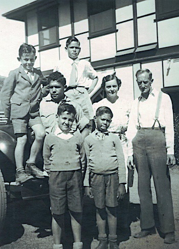 Group of boys ready in Alice Springs in 1944 – Bill Espie, John Palmer (Back), Noel Hampton, Charles Perkins, Malcolm Cooper (standing in front or Mrs Smith), Mrs Isabel Smith, Father Percy Smith
