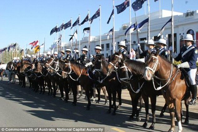 Mounted police line up at the National Police Memorial to commemorate the 757 Australian police officers who have died in the line of duty while serving the community in each state and territory
