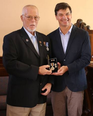 Bob MUNDAY on Friday 22 January 2016 receiving his National Police Service medals from Angus Taylor MP 2 weeks to the day of this presentation, he died.