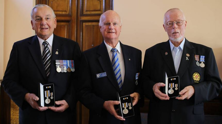 HONOURED: Ray Strong, Ian Radford and Robert Munday were celebrated for their services to policing with the medals.