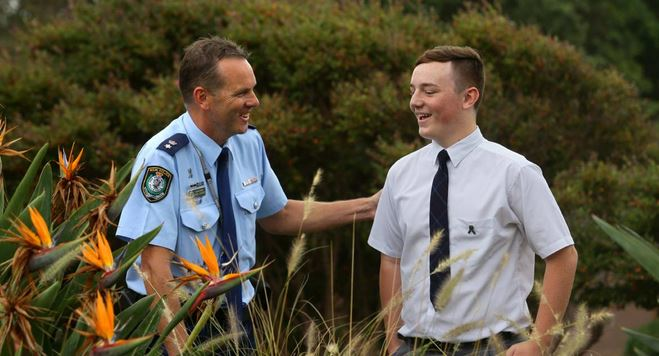 TOUCHED: Port Stephens Superintendent Chris Craner thanks Tom Finlay for his poem about police killed in the line of duty. Picture: Jonathan Carroll.