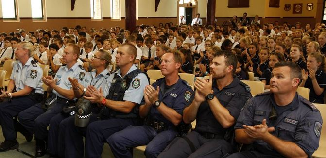 THANKS: Port Stephens police officers at Newcastle Grammar School thank students for their poems dedicated to their late colleague, Sergeant Geoffrey Richardson.