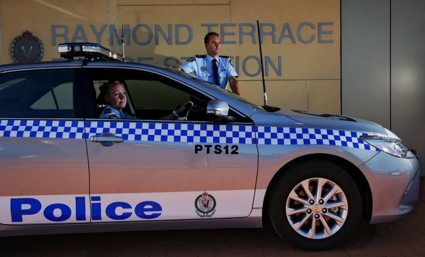 TRIBUTE: Superintendent Chris Craner and Sergeant Martine Morley with the new Port Stephens police car, which is dedicated to Geoffrey Richardson who died in the line of duty in March. Picture: Simone De Peak